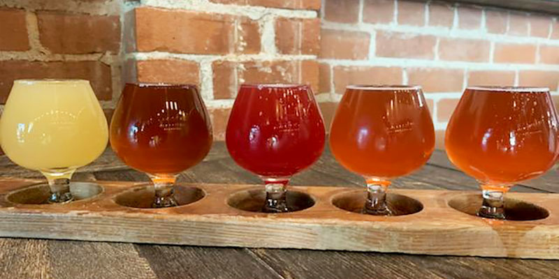 A colorful flight of sour beers at Big Stump Brewery's taproom in Sacramento, California.