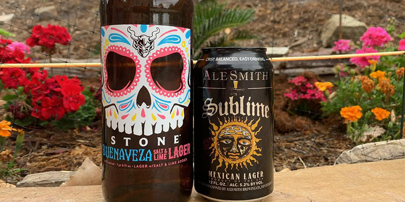 A bottle of Stone Brewing's Buenaveza Salt & Lime Lager stands next to a can of AleSmith Brewing Company's Sublime Mexican Lager.