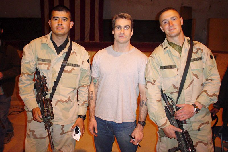 """Donald Lee and Matthew """"Griff"""" Griffen are shown posing with the legendary, yes, legendary, Henry Rollins at an undisclosed location in Afghanistan."""