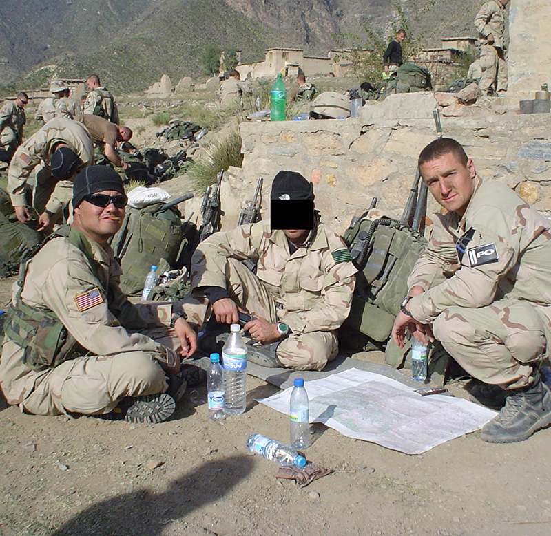 """Donal Lee and Mathew """"Griff"""" Griffin are shown, are shown in the mountains of Afghanistan. A third man is shown, but his face is obscured by a black bar to shield his identity."""