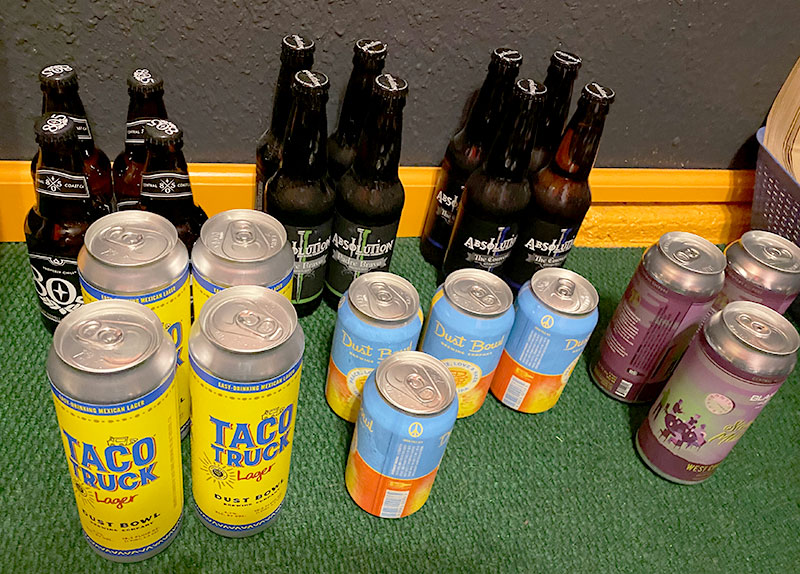 Four each of six styles of canned and bottled beer are shown grouped together.
