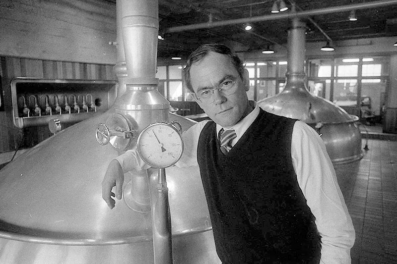 """""""Fritz"""" Maytag leans on a tank inside the Anchor Brewing Company facility."""