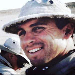 """A younger-looking J. Robert """"Rob"""" DuBois is seen up close and smiling in a desert locale during his days as a Navy SEAL."""