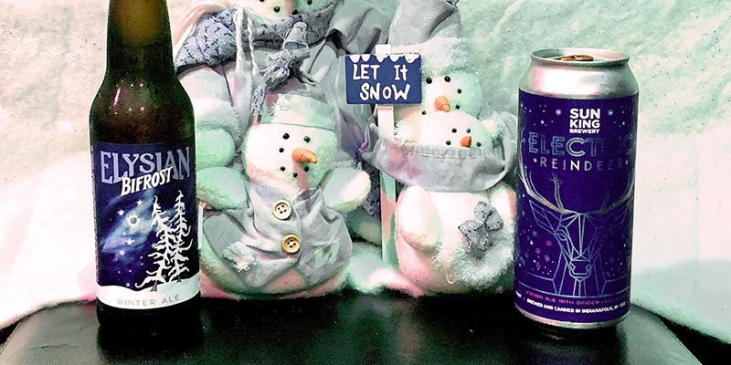 A bottle of Bifrost and a can of Electric Reindeer bookend several stuffed snowmen.